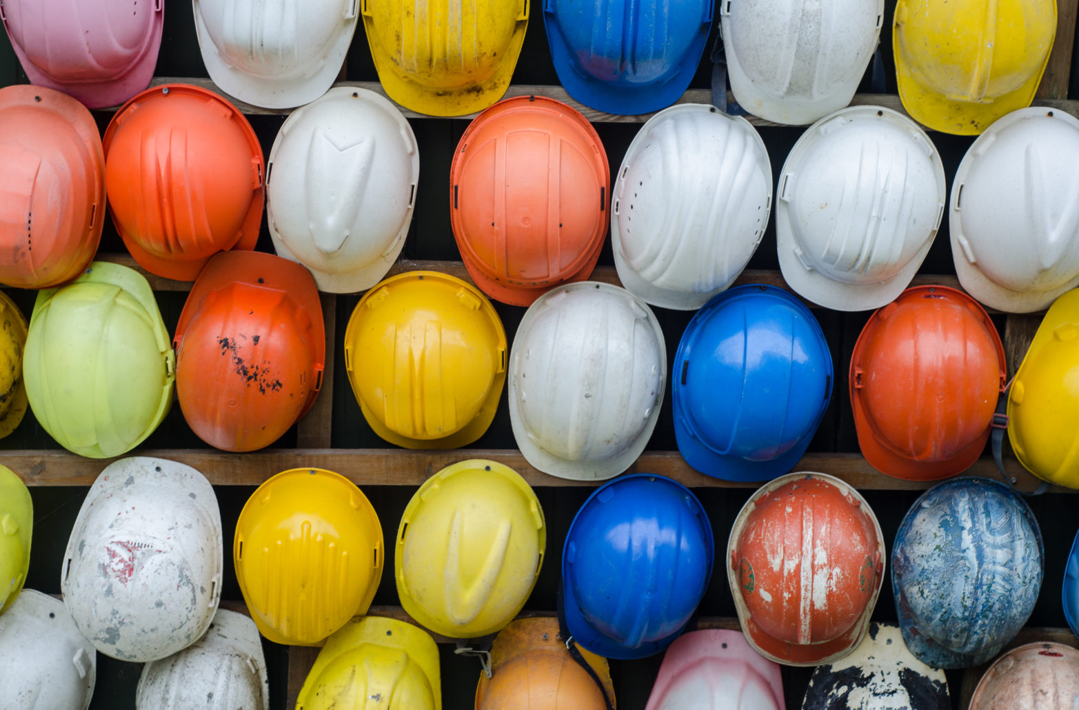 Rows of different coloured hard hats