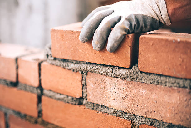Brick layer laying bricks