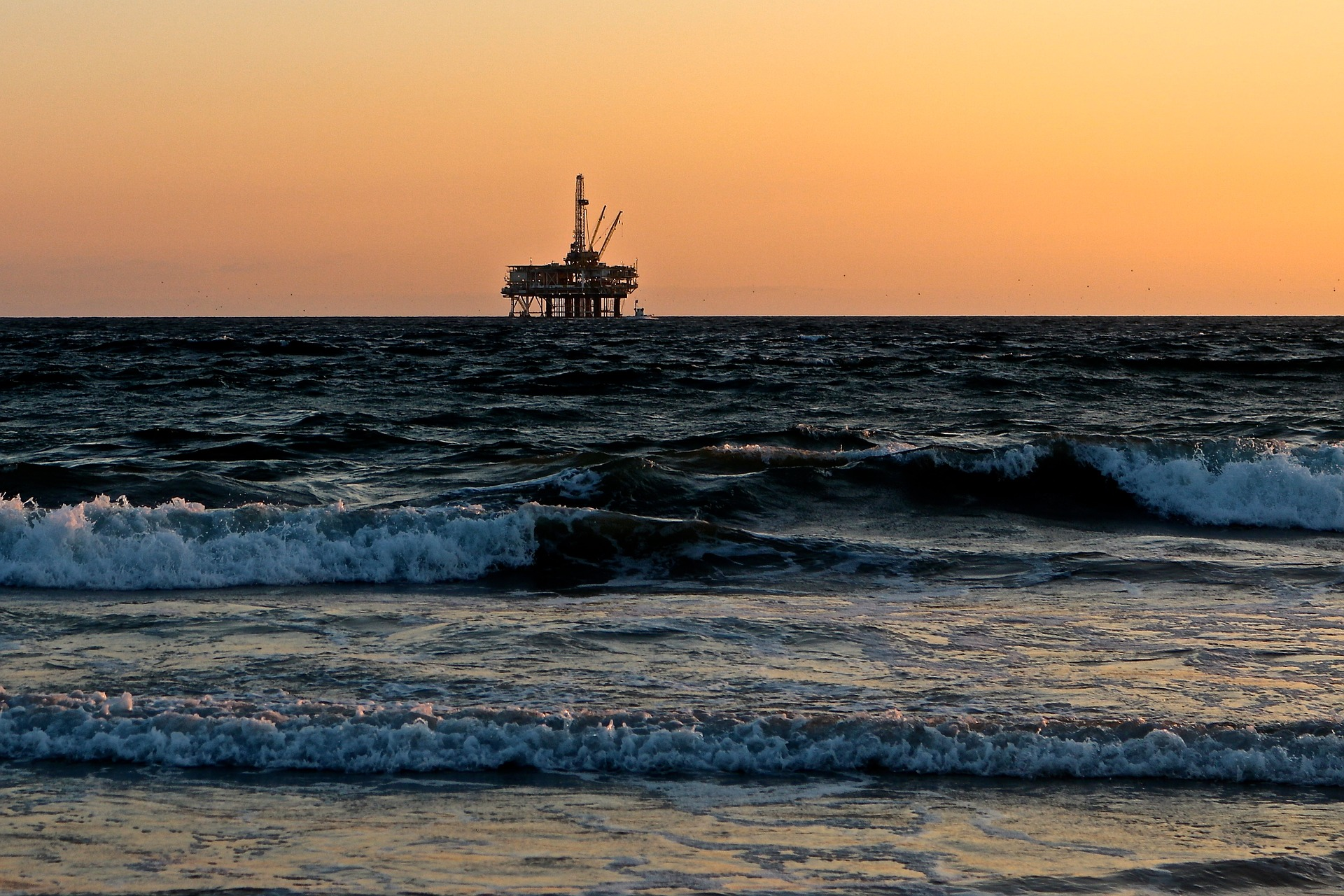 The sea with an oil rig in the distance