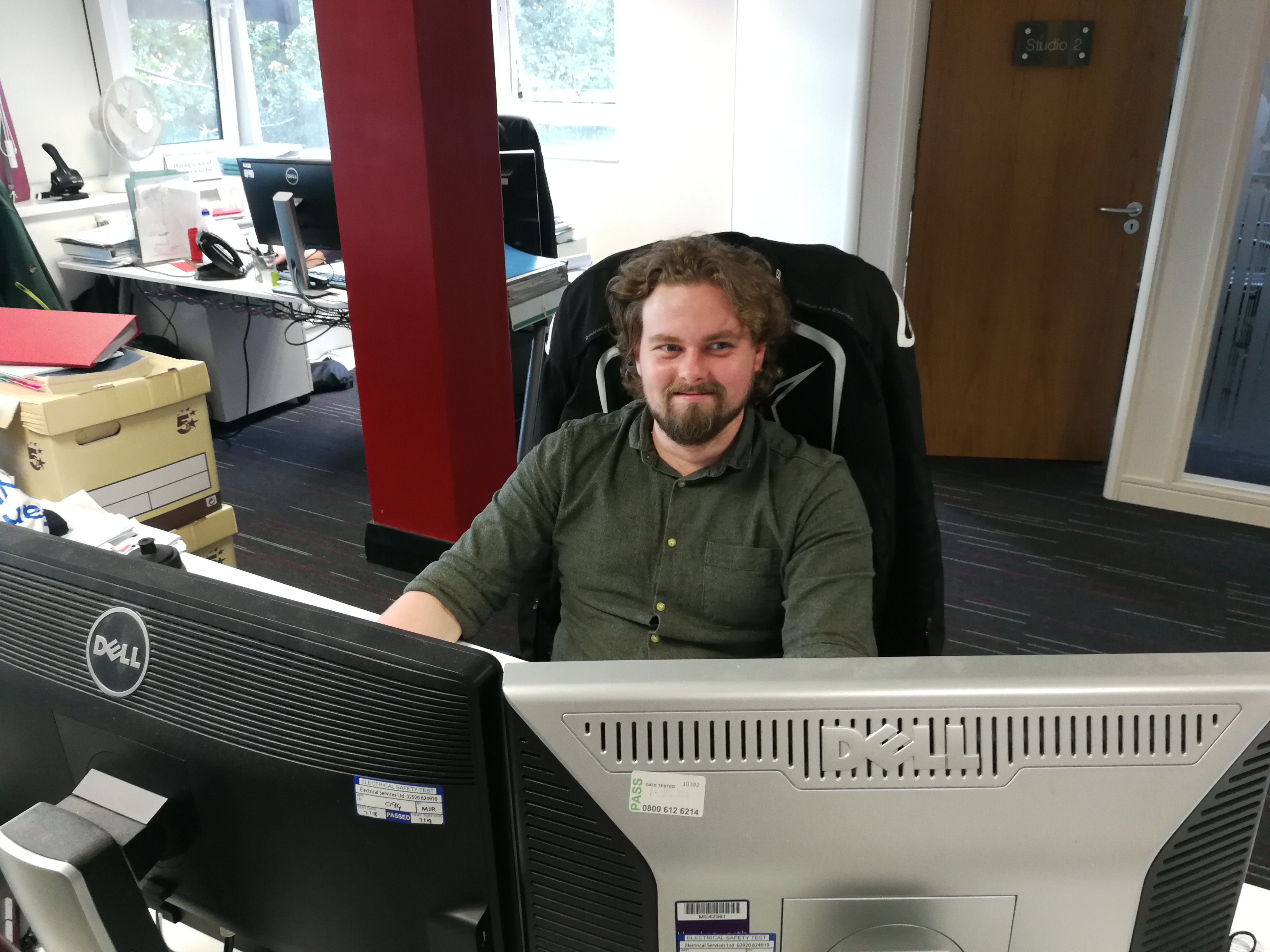 Civil engineer Joel Wall sitting at his desk