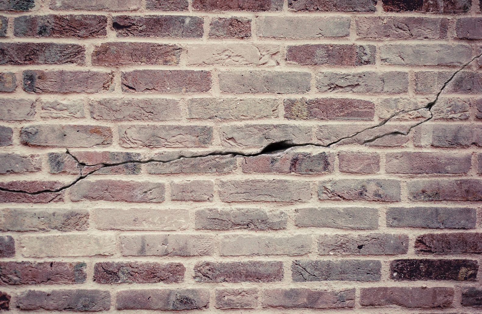 A crack in a wall-a common sign of subsidence.
