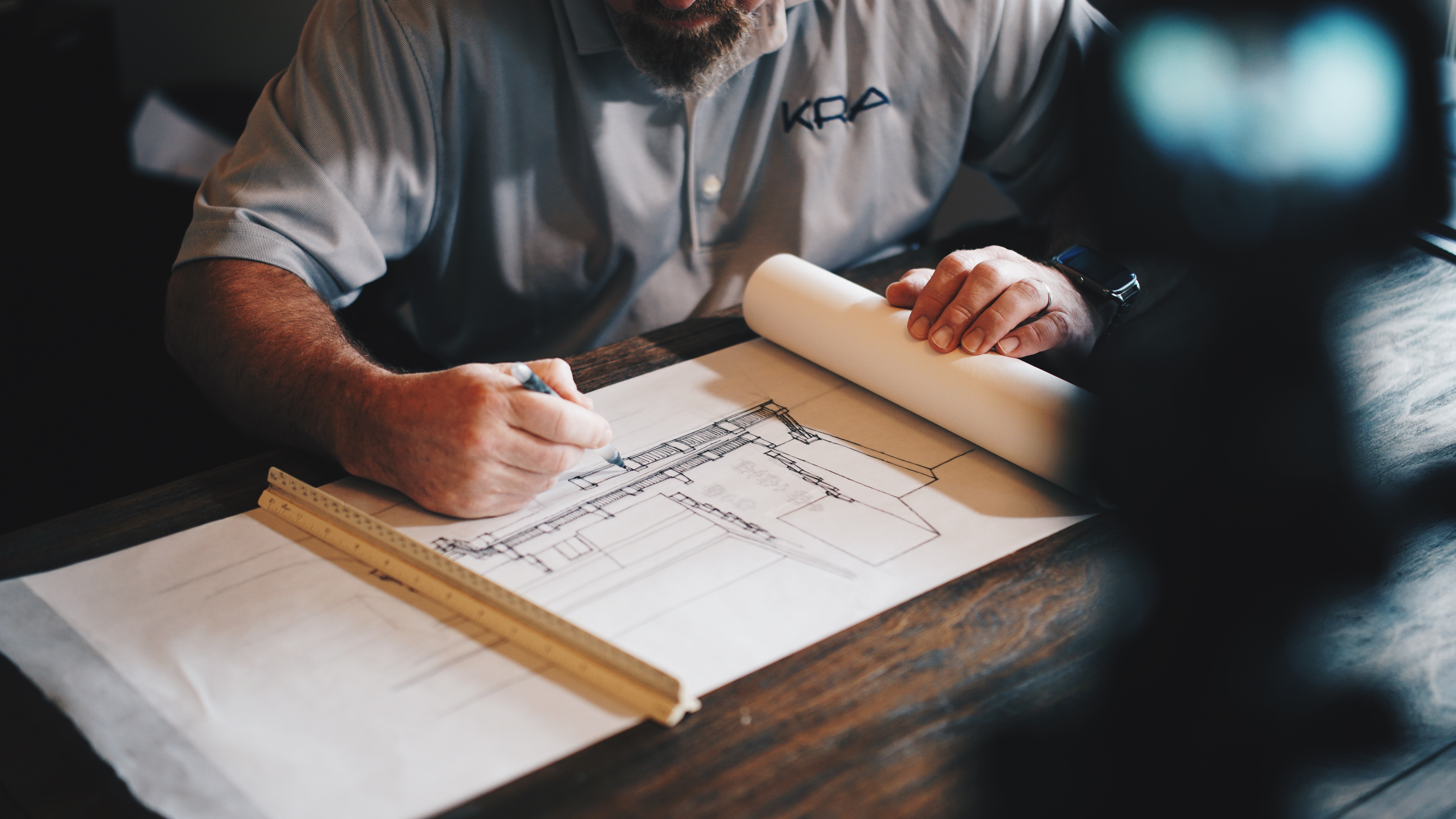 Architect designing a loft conversion by hand